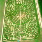 2005: Concerned that Tom was getting all the credit for the Maze designs, the 'others' ingeniously trick Tom into designing a circluar 'landing area'. Unnoticed during the light of day, many night-time maze patrons, report odd lights close to the interior of the Maze. When asked to comment, Tom replied, 'Those are, 'er, lightning bugs. That's it, lightning bugs'.